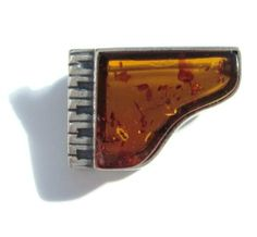 Baltic Honey Amber Sterling Silver Museum Collection Piano Pin 19th Century Ian and Valeri Co.. $70.00. Amber can be classified into several forms. Most fundamentally, there are two types of plant resin with the potential for fossilization