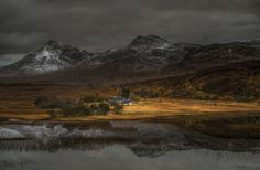 Reflexion in the loch Coultrie by PascalBobillon