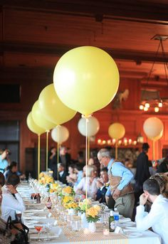 Extra large balloons is an easy (and quirky!) way to fill the space. Image via Rock n Roll Bride .