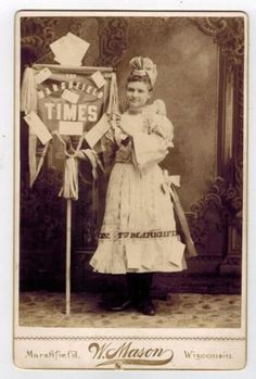 Cabinet-Photo-Young-Lady-Poses-With-The-Marshfield-Times-Sign-Marshfield-Wisc