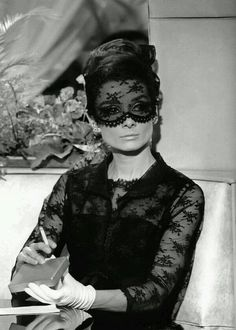 Audrey Hepburn in Givenchy in a scene from 'How to Steal a Million'.