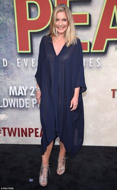 Stunning: Actress Sheryl Lee was outfitted in a billowing blue garment at the premiere...