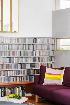 The snug has a more modern feel, thanks to a library of CDs that frames the space. Painted Window Frames, Condominium Interior, Apartment Renovation, Green Velvet Sofa, New Architecture, Cosy Corner, Minimal Home, Study Areas, Open Layout