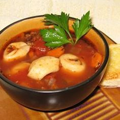 Italian Sausage Soup with Tortellini - Allrecipes.com  this was really popular at a family gathering.