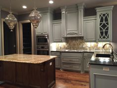 Open kitchen with large island, granite counter tops, and custom tile backsplash.