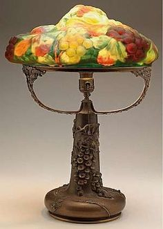 "This is a fine pairpoint ""puffy"" table lamp with a grape pattern shade on a grape trimmed metal base"