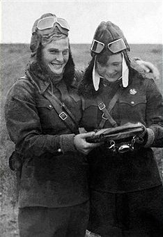USSR. Soviet women pilots Vera Tikhomirova and Mariya Smirnova (L-R) smile as they pose for a photo during World War II. Reproduced by TASS - pin by Paolo Marzioli