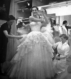 Model being fitted at the Pierre Balmain atelier, Vogue Paris, 1952.