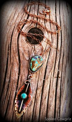 This Beautiful Copper & Brass Feather hangs from a Gorgeous Carico Lake Turquoise Nugget.     I hand cut and textured the copper to look like a