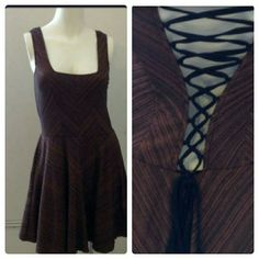 ✌Fit & flare Free People✌ ✨MAKE ME AN OFFER✨ Shades from black, chocolate brown, and gold stripes in the fabric, A line skirt with fitted sleeveless top.  V BACK, adjustable with back criss cross straps.  NWOT NO FLAWS This dress was bought and tried on, didn't fit me right, so has not been worn, however tags removed. Free People Dresses