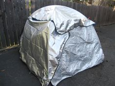 This instructable suggests a way to add thermal insulation to your tent. If you go camping in hot places like Burning Man you'll undoubtably have awoken at 7am bathed in your own sweat. The heat in a tent that is exposed to the morning sun builds up fast, making it hard to sleep in. But since you just went to sleep at 4am, getting at 7am isn't going to work, right? With a little bit of cash and very little time you can thermally insulate your tent. Using sturdy emergency blankets and...
