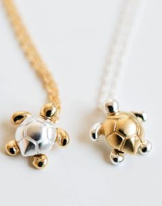Turtle necklaces. Since they're inverse colors of each other, they could serve as a best friend necklace.