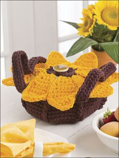 Toting your favorite casserole to the family picnic will be a snap with this pretty and practical carrier. This e-pattern was originally published in Crochet World June 2009. Size: Fits one 2 1/2-quart glass casserole dish with lid. Made with bulky (chunky) weight yarn and sizes H (5mm) and L (8mm) hooks. Skill Level: Easy