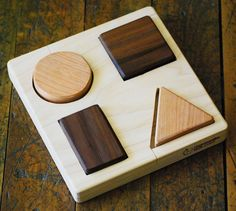 Basic Shapes Educational Wooden Puzzle, montessori preschool natural organic wood classic toy for babies and toddlers. $24.00, via Etsy.