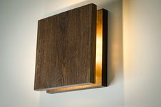 SC Sconce Wooden wall lamp with simple functional design. Soft yellow LED lightning. This lamp has two options: switch is located aside, or with wire. Made of OAK pieces with accent on natural wood texture. Polished and smoothed by hands using durable safe materials for best resistance, and