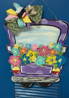 I painted this spring truck door hanger with spring colors and flowers.