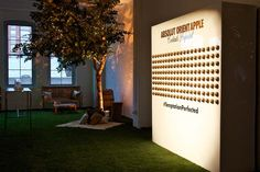 In place of a typical step-and-repeat, the producers created a walls of gold-painted apples for guests to pose beside. The...