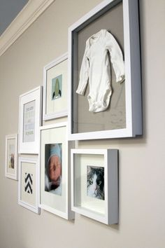 "Nursery gallery wall - onsie mounted in shadow box frame, hospital baby photo, parents photo, family cat, design elements & ""You are the world and the world is yours"" art page - all mounted in Ikea frames! http://thelilhousethatcould.com/category/nursery/"