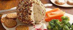Your guests will want the recipe for this cheesy spread filled with crunchy nuts, chopped onion and garlic flavor.  The chopped nut coating makes a good thing even better.