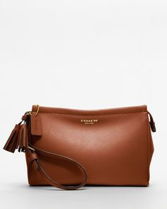 Coach Legacy Wristlet in Cognac. Starting at $1 on Tophatter.com!
