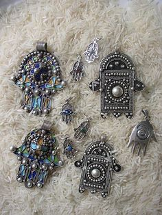 Africa | All of the enamel pieces and the larger Khamsa are Berber.  Sourced from El Kellah Des Sraghna on the Marrakesh Plain, within walking distance of the High Atlas. | Image and caption © David R.E. Hunt