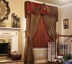 Paisley double swag over solid color valance w/ striped panels and a lot of detail trim
