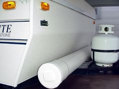"Camping DIY: Pop-up camper mod.  6"" PVC pipe mounted on camper to hold outdoor carpet. It is connected to the frame with internal stainless steel carriage bolts and hardware. A cap on the left and screw plug on the right should keep the carpet nice and dry. Genius!"
