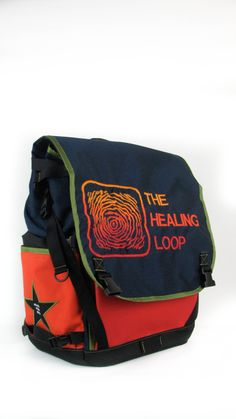 A side view of the waterproof flap top backpack we did for The Healing Loop.