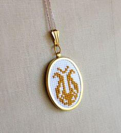 Items similar to Cross Stitch Necklace Yellow Gold Mid Century Folk Design Flower Pendant on Etsy Funky Jewelry, Cat Jewelry, Animal Jewelry, Etsy Jewelry, Cross Stitching, Cross Stitch Embroidery, Easy Stitch, Cross Stitch Alphabet, Floral Necklace