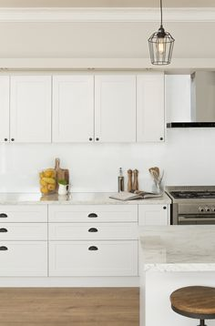 antique white doors and panels with mayonella benchtops | kaboodle kitchen