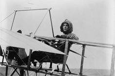 Aviatrix Harriet Quimby with the Moisant monoplane in which she learned to fly.