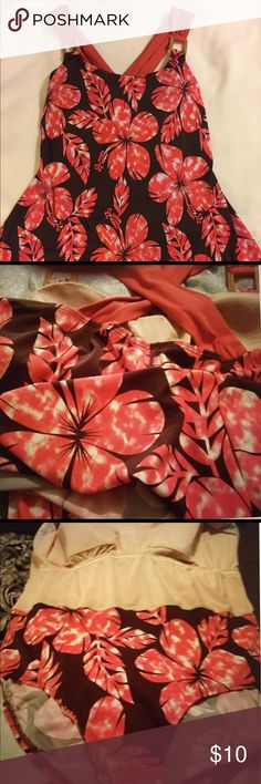 """SWIM DRESS BY """"ISLANDER"""" I purchased this swimsuit here on Poshmark but to my extreme disappointment it is a bit too short from bust to crotch😵❗️ Beautiful and in great condition, showing no wear. The salmon colored straps crisscross in the back & are 2"""" wide, giving comfortable support. No underwire but padded bra. Wooden looking rectangular pieces connect the straps to the suit. The straps are fixed & not removable. True colors are a brown background with salmon (or corral) flowers…"""
