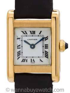 """Cartier Lady Tank """"Normal"""" 18K circa 1970s - <span data-reactid="""".5.2.4.0.0.1.0.0"""">Cartier Lady's 18K GoldTank """"Normal"""" circa 1970's. Featuring 22 X 30mm rectangular casesecured by 4 case screws. Featuring classic white enamel dial with printed black Roman numerals and blued steel hands and signed SWISS. Powered by 17 jewel manual wind Cartier signed movement, with cabochon sapphire crown. With unsigned black genuine crocodilestrap and <em>plaque</em> Cartier buckle. Recently serviced and…"""