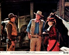 CHISUM (1970) - Ben Johnson, John Wayne & Pamela McMyler on location in Durango, Mexico - Directed by Andrew V. McLaglen - Warner Bros. - Movie Still.
