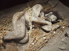 At Shanidar Cave in Iraq there is the questionable flower burial dating to 60,000 years ago. Of nine Neanderthal skeletons found, one burial contained botanical remains of flowers including pollen, perhaps evidence of mortuary ritual. However, it is hard to ascertain whether the botanical remains were deliberately added, or whether the wind blew them into the pit that was used to prevent a dead body from polluting the site or attracting predators. Image JohnConnell Flickr