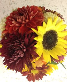Fall wedding bouquet- this is the shade of deep red/ burgundy I am picturing for my wedding day- minus the sunflower