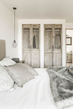 GoGalicia - Detail of the beautiful asian doors used for the wardrobes. Minimal Bedroom Decor and Inspiration