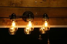 $159 - Mason Jar Vanity Light Wall Sconce - 3 Mason Jar Bathroom Light - Edison Bulbs Included by Industrial Rewind, http://www.amazon.com/dp/B00CC6ER1S/ref=cm_sw_r_pi_dp_NDBYrb07GEQE1