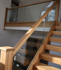 glass and wood stair railing More