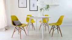 White Dining Table and Yellow Eames Chairs