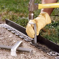 Use a garden spade to edge the perimeter of the path. Excavate the area (depth will depend on height of the pavers) and level the surface. Bend plastic edging to conform to the shape of the path and secure with rods.
