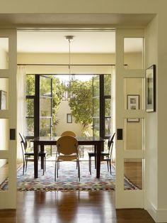 open space; steel panes in French doors to patio (Bliss Nor-Am or Hope Windows + Doors); sliding French doors from entry hall