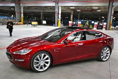 """Tesla's """"Summon feature"""" can open the garage door, park itself and shut down without a driver in the car."""