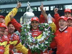 Juan Pablo Montoya, of Colombia, hoists a bottle of milk in victory lane. Indy Car Racing, Indy Cars, Indy 500 Winner, Indianapolis Motor Speedway, Usa Today Sports, Car And Driver, Car Humor, Champs, Sport