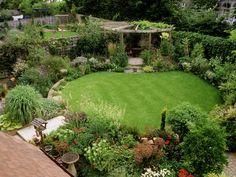 Circular lawn surrounded by plants, with pergola