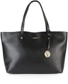 b4a6b54f8365 Leather Tote Bag Spacious design adorned with gleaming logo at front Double  top handles