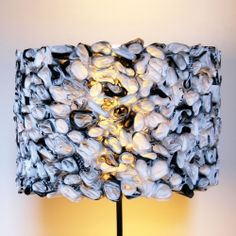 I made this fun black and white ruffled drum shade out of a special material, can you guess what it is?