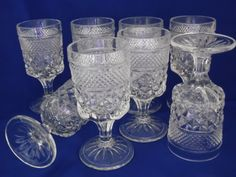 SOLD I remember these!  I don't know if it was the thickness of the glass or the elegant stem.... these always made orange juice just plain taste better.  Juice Glasses Stemmed Wexford Pattern Early by TheMichiganAttic