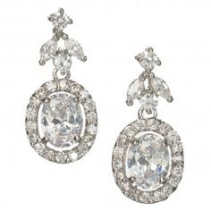 Gorgeous oval cubic zirconia drop earrings. Just the perfect size. Round and marquis shaped stones shaped in a floral motif lead to the larger oval stone encrusted with tiny hand set stones. * Length .75