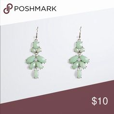 Hanging Statement Earrings Not available in stores! These swinging stunners are detailed with unique green gemstones, delicately strung with silver tone settings. torrid Jewelry Earrings